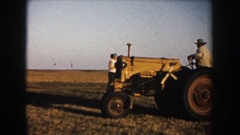 1953: a woman with glasses smiling and some farmers harvesting SOUTH DAKOTA Stock Footage