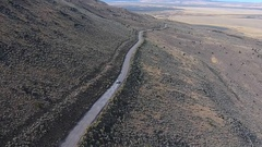 Car on a dirt road Hart Mountain Antelope Refuge Aerial Oregon Stock Footage