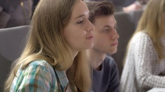 Clever attractive student asking a question in the lecture Stock Footage