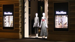 Mannequins in showcase of fashionable clothes store on shopping street of Vienna Stock Footage