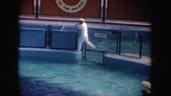 1962: man in white uniform walks along pool CALIFORNIA Stock Footage
