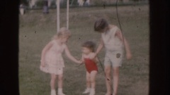 1955: group of young children playing in the park NEBRASKA Stock Footage
