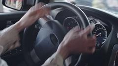 Female Hands of Steering Wheel Stock Footage