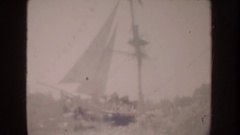 1962: a sailing ship, a family on vacation at a parade, and a brass band Stock Footage