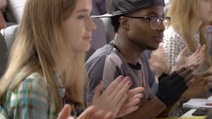Many students applauding in the university auditorium in a lecture Stock Footage