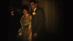1954: adult couples at a formal party posing and smiling, and exiting SOUTH Stock Footage