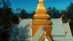 Aerial: Temple next to the sea near Surin beach. Stock Footage
