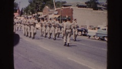 1954: four rows of soldiers march down a street on a sunny day SOUTH DAKOTA Stock Footage