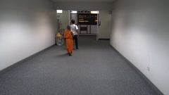 4K A kid monk passenger Moving Between Gates Inside the arrivals at Airport-Dan Stock Footage
