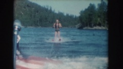 1954: a man waterskiing behind a motorboat during the summer SOUTH DAKOTA Stock Footage
