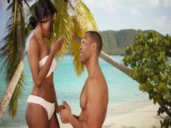Man proposing to fiancee on Caribbean beach Stock Footage