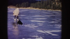 1955: people trying out forward and reverse skating skills together IDAHO Stock Footage