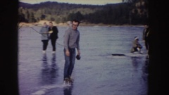 1955: people skating on a large natural pond IDAHO Stock Footage