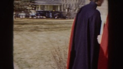 1955: nurses in red and black capes entering a building IDAHO Stock Footage