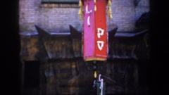 1957: people was pass a chinese restaurant while camera pans from up to down. Stock Footage