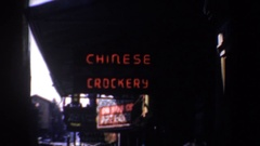 1957: city showing 'chinese crockery' sign and traffic SAN FRANCISCO CALIFORNIA Stock Footage