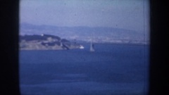 1957: partial view of a bridge lifted over the water, a city being seen in the Stock Footage