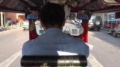 4K Passenger travel in tuk tuk ride through the street Asia City of Bangkok -Dan Stock Footage