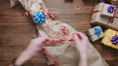 From above shot of person unwrapping present Stock Footage