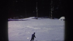 1962: person skiing on ski slopes regains balance after nearly falling. NEW Stock Footage