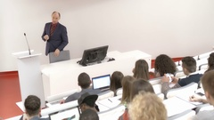 Professor teaching many college students in the auditorium Stock Footage