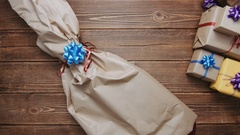 Person opening present in excitement Stock Footage
