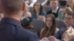 Many interested students listening to a speaker in the university auditorium Stock Footage