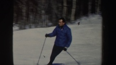 1962: a single person in a blue coat skiing down a hill NEW HAMPSHIRE Stock Footage