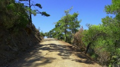 Driving on roughly stabilized soil road towards sea along the river Stock Footage