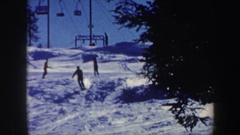 1962: people playing with scatting,around the snowfall VERMONT Stock Footage