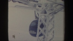 1962: two people in different colored cars riding on a zip line NEW HAMPSHIRE Stock Footage