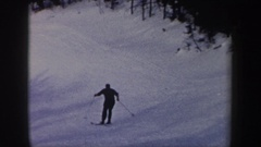 1962: a person in black clothes skis down a ski slope alone NEW YORK Stock Footage