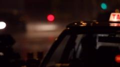 CU Passenger getting into taxi at night / Hong Kong, China Stock Footage
