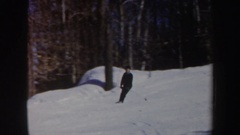 1962: man quickly skiing in snow down a mountain path in the forest on a sunny Arkistovideo