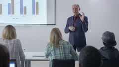 Experienced lecturer wearing a suit answering to a question Stock Footage