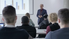 Experienced lecturer wearing a suit holding a university lecture Stock Footage