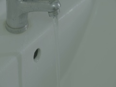 Water pouring from kitchen faucet or bathroom faucet Stock Footage