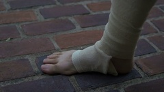 Injured foot injury bandage hurt physical therapy Stock Footage