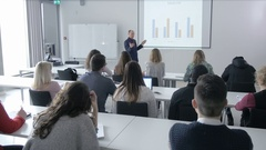 Lecturer speaking in front of a group of college students in a lecture Stock Footage