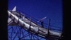 1962: man defies most people's fears as camera man zooms in for roller coaster Stock Footage