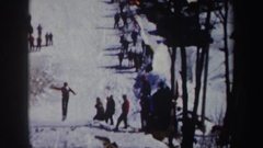 1962: people gathered to watch downhill ski jumps. NEW YORK Stock Footage