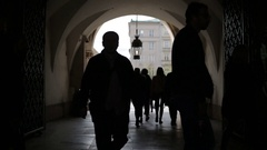 Many people passing through Cloth Hall in Krakow, Poland Stock Footage