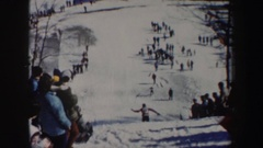 1962: ski jump contest and a skier lands and falls, sliding towards the end Stock Footage