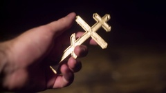 Russian orthodox christian cross suppedaneum hold Stock Footage