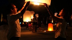 Tourists Releasing Sky Lanterns at Loy Krathong Festival in Chiang Mai, Thailand Stock Footage