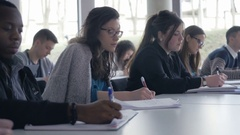 Close-up of many students participating in a lecture and taking notes Stock Footage