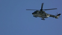 Helicopter Black Sky, helicopter flying over mountain Stock Footage