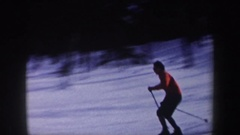1962: a single person skiing a downhill slope during the winter time. NEW YORK Arkistovideo