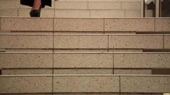 Beautiful woman stepping down stair, close-up female legs Stock Footage