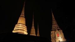 WS LA Stupas illuminated at night / Wat Pho, Bangkok, Thailand Stock Footage